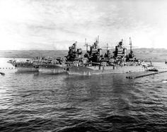 Three sisters photographed shortly after the conclusion of the Gilberts Campaign. The battleships, in an anchorage protected by anti-torpedo nets, are (from left to right): USS Idaho (BB-42); USS New Mexico (BB-40); and USS Mississippi (BB-41).