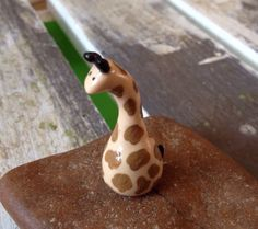 A personal favorite from my Etsy shop https://www.etsy.com/listing/276875200/miniature-polymer-clay-animal-giraffe