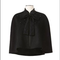 Neiman Marcus women's cape one size Brand new with tags Neiman Marcus for Target women's cape. One size fits most. Such beautiful detailing! In perfect condition Neiman Marcus Jackets & Coats Capes