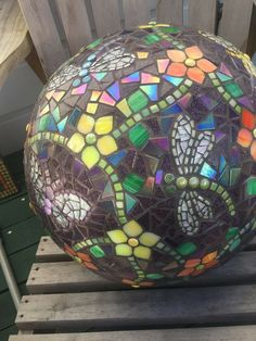 Mosaic ball with flowers and butterflies