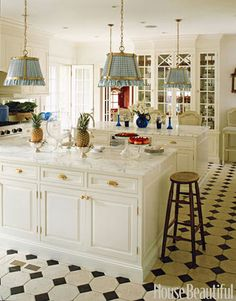 """Dual Islands                                                          Homeowner and interior designer Anne Miller uses both islands as seating areas at kitchen dinner parties. """"The built-in breakfront was designed to look like a piece of furniture, with glass fronts and mirror-backed cabinets to reflect the glassware,"""" she says"""