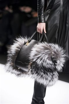 J Mendel - This bag is quite suited to formal wear because of the black colour and leather, but the fur adds a lot of fun to it. The different textures of the smooth leather and fluffy fur make the bag more interesting.
