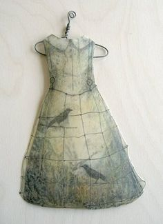 """Paper Dolls"" by Alicia Tormey ""I have been making paper dresses this week and dipping them into encaustic medium (bee's wax & resin). Thought I would share my favorite dress here. I love the way the little hanger turned out too. The dress with hanger measures 10"" tall by 6"" wide."" (Nov 2008 Art Blog)"