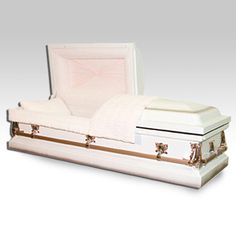 The Gurnee White Metal Casket is made from metal with a white with orchid shade finish. The inside is a pink crepe. The casket is a half-couch design. The interior also includes a matching pillow and throw. The exterior, meanwhile, is decorated with traditional corners, accessories and full handle bars.