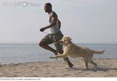 man_running_with_dog
