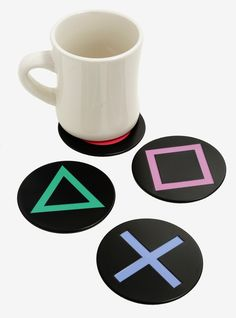 Playstation Metal Coaster Quench your thirst keep your tables from getting ruined and show of your love of gaming. This set of coasters features metal Playstation button logos and soft cork bottoms.