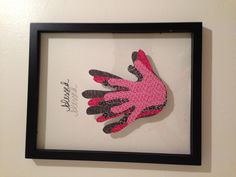 Family handprints in a floating frame