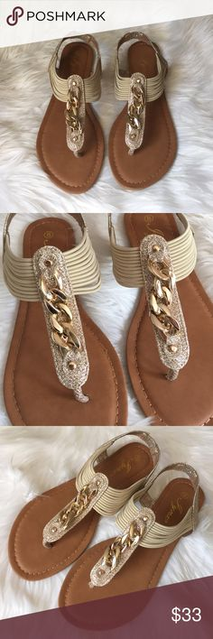 •Glitter Chain Sandals• No warm weather outfit is complete without a cute pair of thong sandals,featuring pull-in style/chain accents/T-straps and side elastic cords for a an adjustable fit/lightly cushioned insole for more comfort/rubber outsole/new in box/thanks for lookingcolor: Gold                                                                                                 ❌No Trades❌ Shoes Sandals