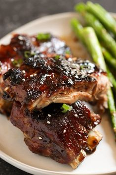 Sticky Asian Ribs (in the OVEN!) - - Salty but sweet and covered in a delicious sticky sauce - our Sticky Asian Ribs will be your new BBQ staple. Oven Baked Beef Ribs, Dutch Oven Ribs, Ribs Recipe Oven, Ribs In Oven, Asian Ribs, Asian Beef, Asian Short Ribs, Pork Rib Recipes, Asian Recipes