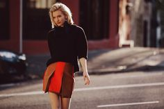 Zanita Morgan Photographed by Gervin Puse. earrings, House of Baulch at Jasu (on sale!) pleated mini skirt, Ellery at Jasu roll neck knit, Skin and Threads at Jasu