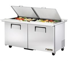 """@MADE IN USA SALE!     Dual Side Mega Top Sandwich/Salad Unit, (24) 1/6 size (4""""D) poly pans, (2) stainless steel insulated covers, 11-3/4""""D cutting boards, stainless steel top/front/sides, aluminum back, (2) full doors, (4) shelves, white aluminum int with 300 series stainless steel floor, 5"""" castors, 1/3 hp, 115v/60/1-ph, 7.8 amps, 7' cord, NEMA 5-15P, cUL, NSF, CE."""