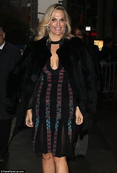 Flawless fashionista: Sims accessorized her ensemble with a simple black choker and strappy peep toe wedge heels while draping a coat over her shoulders to keep warm