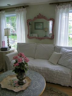 Shabby Chic  Love the thick black rods agains the light colors.