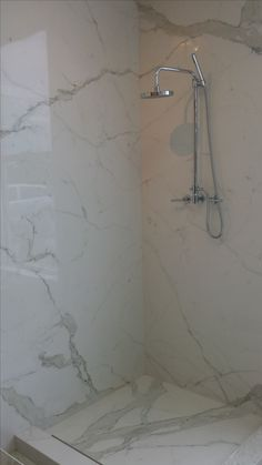 This is a grout less maintenance free shower system using the Plane product. Callacatta Plane