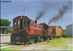 Arkansas & Missouri T6s #12 and #18 perform switching work in Van Buren, Arkansas on May 14, 1999.
