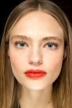Topshop Unique - Lynsey Alexander created a make-up look inspired by Nineties club girls at Topshop Unique, with a blurred red lip, worn-in mascara and dewy skin.