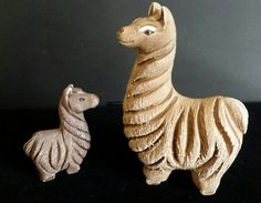 Hey, I found this really awesome Etsy listing at https://www.etsy.com/listing/476828633/rinconada-llama-alpaca-pair-of-figurines