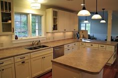 Tons of countertop space for food preparation and entertaining. Love the mullion door cabinets on both sides of the sink.   http://www.cliqstudios.com/mission-kitchen-cabinets