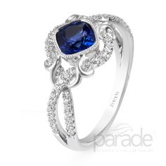 Parade's award-winning Lyria platinum design is the perfect pairing of sleek modernism with vintage romance. Satin brushed flourishes and gracefully intertwining rows of diamonds accentuate a cushion-cut sapphire.