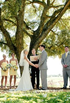 The ceremony took place under a giant oak tree at Healdsburg Country Gardens. Wedding Planner: Elsa Vera Productions Wedding Venue: Healdsburg Country Gardens Wedding Photographer: Tia & Claire Studio
