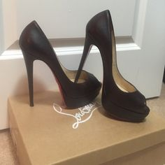 Christian Louboutin 150 Cacao platform Like new dark brown platform heels with peep toe detail. Comes with duster bag and original box. Red rubber on sole so no scratches on the red bottom. Christian Louboutin Shoes Platforms