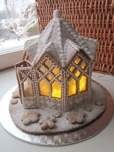 A very tranquil Christmas Gingerbread house. I love the melted candy 'stained glass' windows! Gingerbread House Designs, Gingerbread Village, Christmas Gingerbread House, Christmas Sweets, Christmas Cooking, Noel Christmas, Christmas Goodies, Gingerbread Cookies, Christmas Crafts