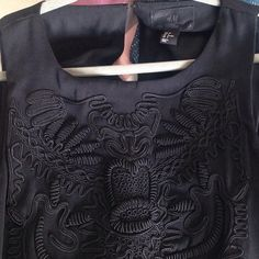 H&M black dress. Sexy black dress,  embroidered on the top and has a slit in the back. size 8. New, with no flows or stains. No trades/ offers are always welcome H&M Dresses Midi