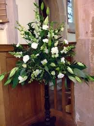 Image result for elaborate triangle white flower arrangements for wedding