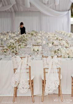 All white with lace/eyelet chair ribbon. Forget Me Not Flowers.