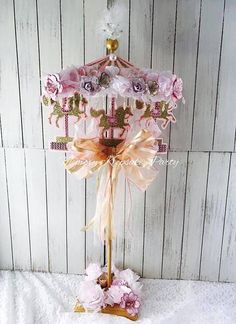 A beautiful Carousel Centerpiece for the right touch at your Carousel Birthday Party or Baby Shower. Weve taken the concept of a Carousel birthday party and elevated it with high quality glitter cardstock. This Carousel decoration is further distinguished with the use of real