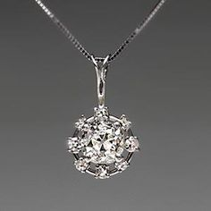 Solid platinum Victorian Era diamond pendant. One large old mine cut diamond with eight single cut round diamonds encircling it. Stunning, elegant, vintage, perfect for that black dress with the v-cut.