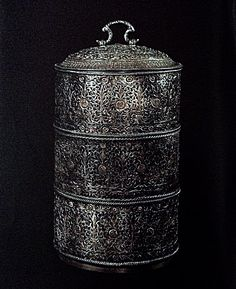 Three layered food containers of filigreed silver.  Chinese craftsmanship. Height. 27 cm.