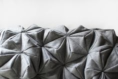 Bloom blanket. A cozy piece of art, inspired by origami, for anyone to have at home.