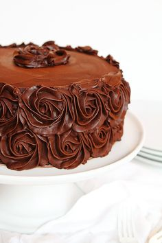 Perfect chocolate buttercream frosting (and cake) from I am Baker. Frosting recipe adapted from Savory Sweet Life.