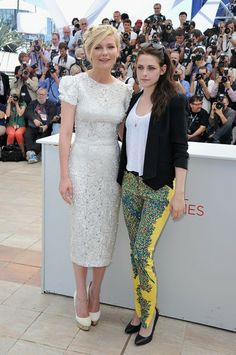 CANNES, FRANCE - MAY 23:  Actresses Kristen Stewart and Kirsten Dunst (R) attend the 'On The Road' Photocall during the - 65th Annual Cannes Film Festival at Palais des Festivals on May 23, 2012 in Cannes, France.
