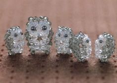 Weave owls of crystals. (There are also : Nemo; begging dog; grey terrier dog; and a crystal turtle.)