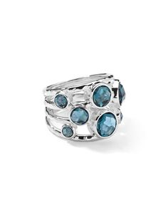 Starry stones unite this multi-banded ring.