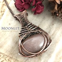 By Moonlet Handcrafted Jewelry. Soothing and shimmery peach moonstone blends weaving with clean lines and a criss cross pattern accented by antiqued copper weaving. Included is a matching antiqued copper chain. Wire Pendant, Pendant Jewelry, Pendant Necklace, Wire Wrapped Necklace, Wire Wrapped Pendant, Copper Jewelry, Wire Jewelry, Jewlery, Handmade Copper