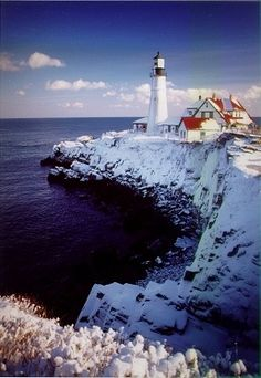 How gorgeous does Portland Headlight in Cape Elizabeth, ME look all covered in snow?