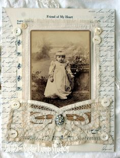 Mixed-media collage handcrafted on canvas with vintage laces, mother of pearl buttons, old hymnal music, and original cabinet card, finished with antique Battenburg lace and a rhinestone embellishment