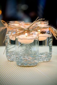 How cute would this be? Put a couple jars in the middle of the table, surround them with leaves and mini pumpkins & gourds!!