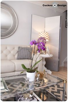 grey, white and gold living room. love the glass coffee table