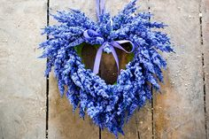 This heart shaped flower decor is so adorable, I love the bright lavender color. Use your favorite flowers to make it unique.