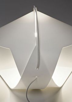 Hanor lamp from prandina. Single sheet of PMMA is bent into shape of a lamp through a delicate folding process.