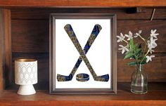 This colorful St. Louis Blues Hockey Puck and Stick print is an original…