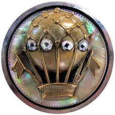 Victorian button with brass, cut steel & mother-of-pearl.