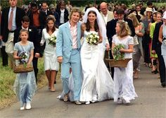 Jamie Oliver could havebeen Jools' 'something blue' on their big day back in the year 2000 as he wore an unusual Paul Smith suit with snake-skin brogues.  Jools' figure hugging weddinggown complimented her figure beautifully and she wore a long veil with a tiara to accessorise her look.