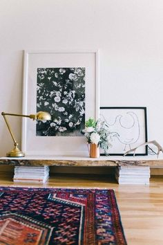 What do you think about artwork being stacked, or rested on a sideboard/console table?