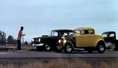 Drag Racing in American Graffiti Movie. Left angle shot.