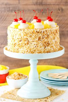 This Pina Colada Layer Cake has moist layers of coconut cake, homemade pineapple filling and coconut frosting! Topped with toasted coconut, cherries and pineapple for a tropical treat that screams spring! Coconut Pineapple Cake, Coconut Frosting, Coconut Cakes, Lemon Cakes, Pina Colada Cake, Cake Recipes, Dessert Recipes, Baking Recipes, Smooth Cake